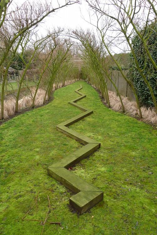 Garden of Galerie De Ziener, Asse, B.  by Norman Dilworth